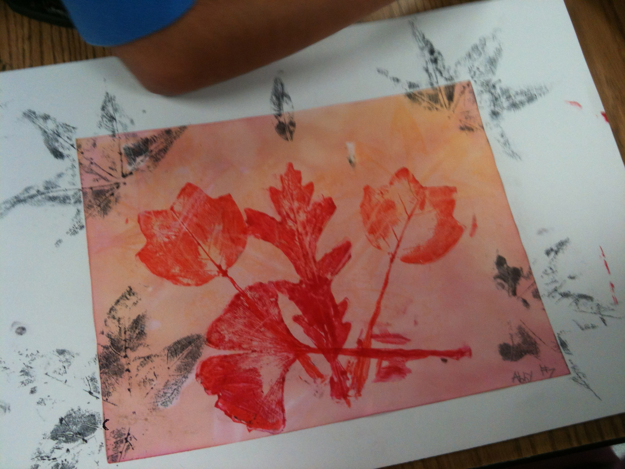 Red/orange leaf prints were made with rubber leaf stamps