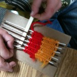 'Primary weaving' loom. We use popsicle sticks instead of plastic needles.