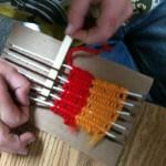 'Primary weaving' loom. We use popsicle sticks instead of plastic needles.