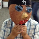 Student-made papier mache mask