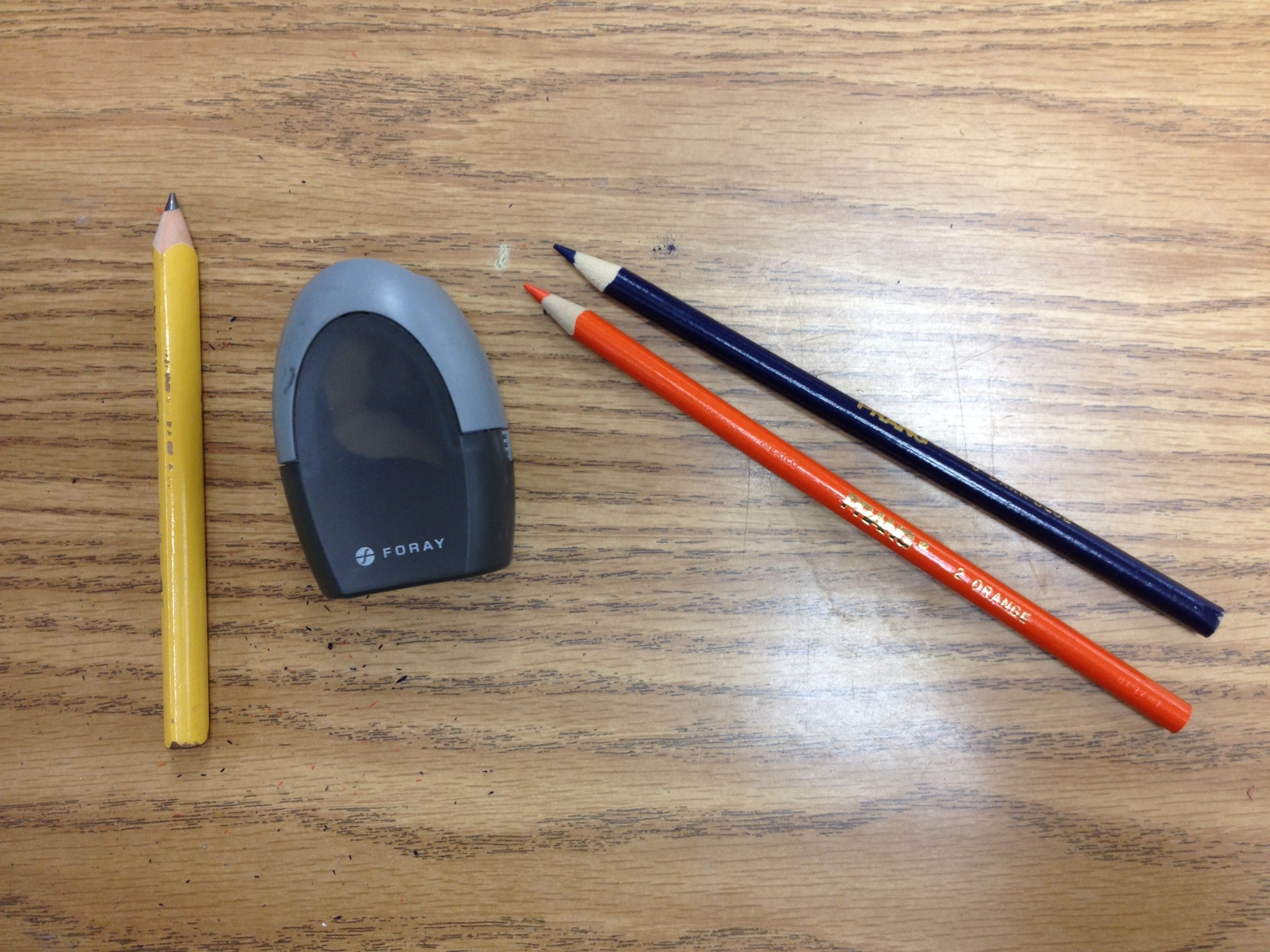 Foray manual pencil sharpener works great on large and small pencils and colored pencils.