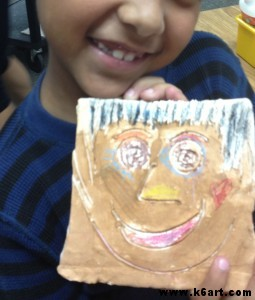 clay portrait tiles painted with tempera