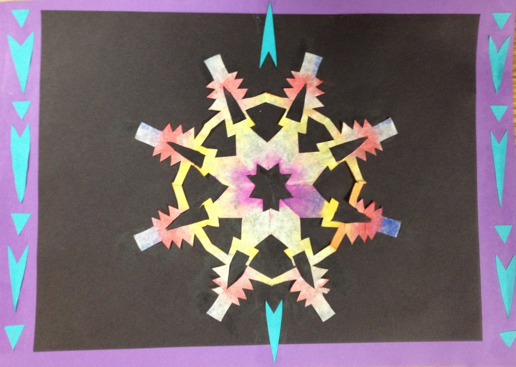 Sixth graders cut and paint coffee filter snowflakes, then use them in a collage. Allow two 40-minute classes.