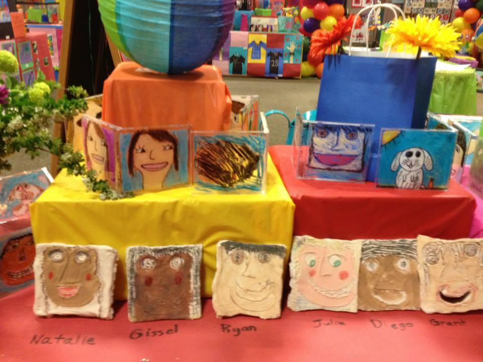 Self Portraits: 4th grade CD case double portraits, 1st grade clay self portraits.