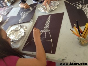 We used mat board scraps and white paint to print the Eiffel Tower.
