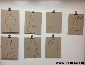 Students drew one holiday shape on cardboard, then cut it out.