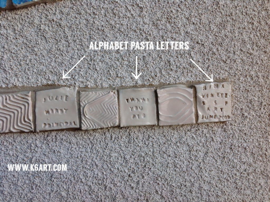 For the small text, we pressed alphabet pasta into the clay tiles.