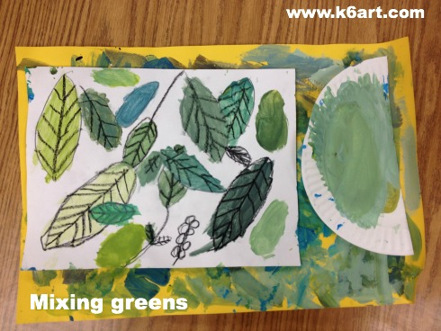 Students used tempera paint to create many shades of green.