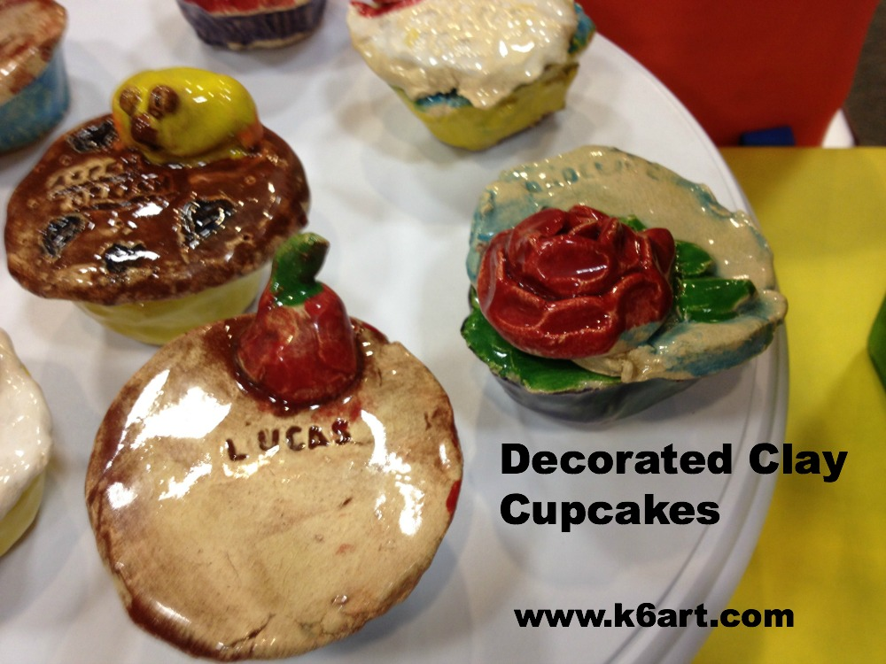 decorated clay cupcakes feature text and roses.