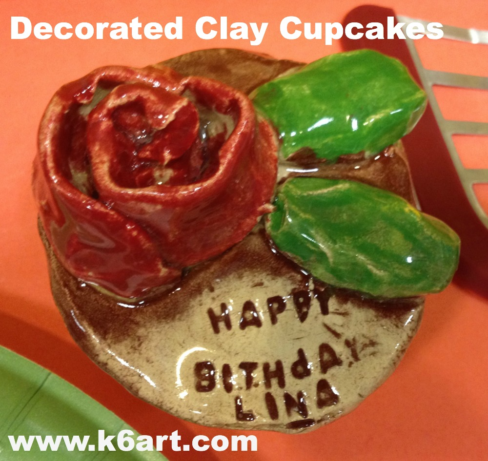 decorated clay cupcakes feature lettering and clay roses and