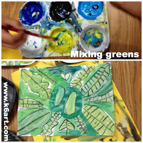Second graders used blue, turquoise, yellow, black and white tempera to mix shades of green.