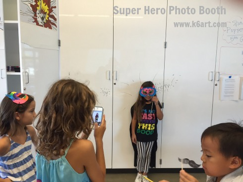 Students photograph each other as super heroes.